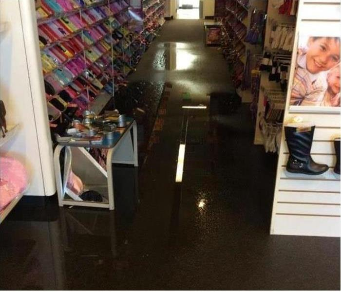 Shoe Store Water Damage Before
